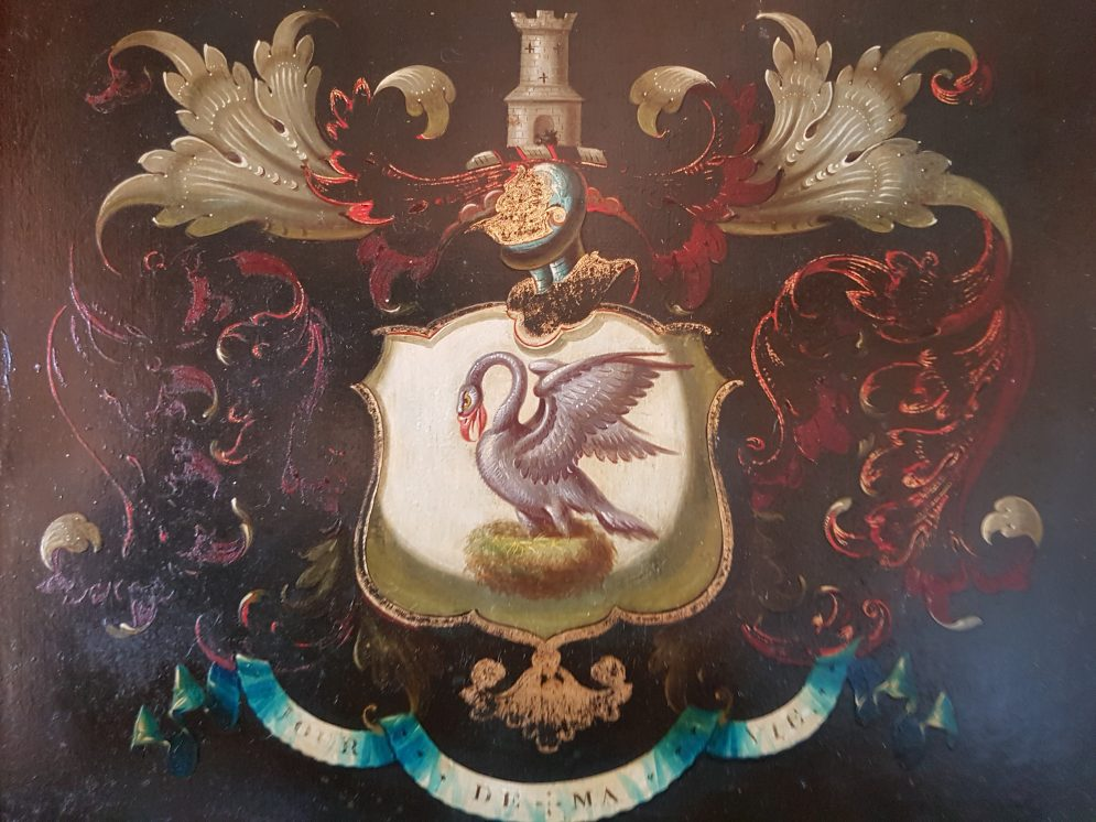 British noble crest with a swan and motto